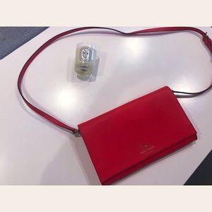 Red Kate Spade cross body bag